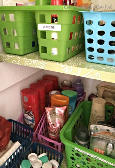 Storing bath and body products in magazine organizers via ComeHomeForComfort.com