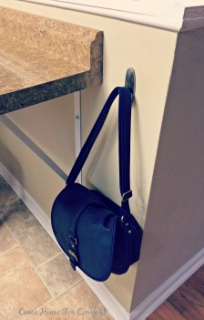 Get Organized Using Hooks to Corral Purses via ComeHomeForComfort