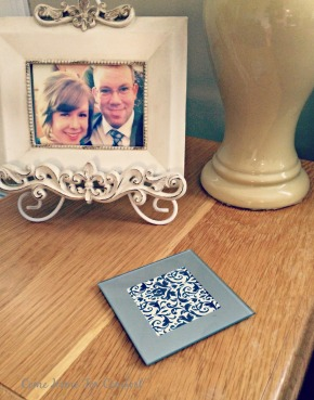 Put pretty scrapbook paper in photo coasters to add interest to your decor via ComeHomeForComfort.com